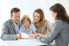 Family with real-estate agent Royalty Free Stock Images