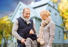 Happy family over living house in autumn stock photography