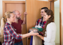 Family receiving visitors Stock Photography