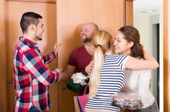 Family receiving visitors Royalty Free Stock Photo