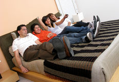 Family reclining in bed Stock Photos