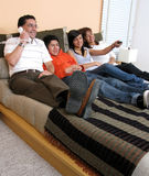 Family reclining in bed Royalty Free Stock Images