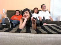 Family reclining in bed Stock Images