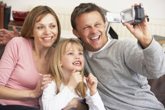 Family Recording With Video Camera Royalty Free Stock Image