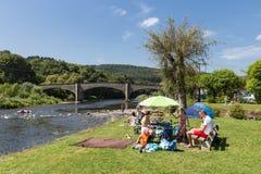 Family recreating near the riverside of the river Semois, Belgium Stock Photography