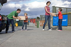A family recycling cardboard boxes Royalty Free Stock Image