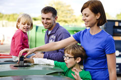 A family recycling a mobile phone Royalty Free Stock Photo