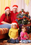 Family in red christmas hat Stock Image