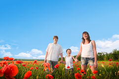 Family in red poppy field Royalty Free Stock Photography