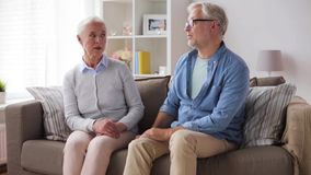 Senior couple having argument at home. Family, relationship difficulties, age and people concept - senior couple having argument at home stock video