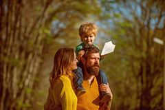 Family relationship. Wife and husband with little baby son enjoy sunny day in park, genetic relationship. Trusted. Partner with similar thinking stock photography