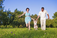 Family and Relationships Concepts. Happy Young Family Spending Time Together. Outdoors on Nature. Horizontal Image Stock Image
