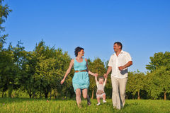 Family and Relationships Concepts. Happy Young Family of Three People Together. Family and Relationships Concepts. Happy Young Family of Three Running Together Stock Images