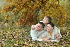 Family relax in autumn park Stock Photos