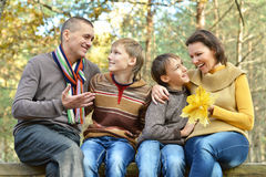 Family relax in autumn park Royalty Free Stock Images