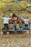 Family relax in autumn park Royalty Free Stock Photography