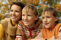 Family  relax in autumn park Royalty Free Stock Photo