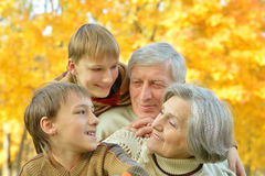 Family relax in autumn park Royalty Free Stock Image