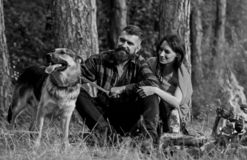 Family relax concept. Couple in love or young happy family. Spend time together. Couple with german shepherd dog near bonfire, forest background. Woman, men and stock photos