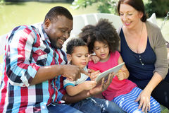 Family Relax Happiness Using Tablet Concept Royalty Free Stock Photography