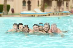 Family relax in  pool Stock Images
