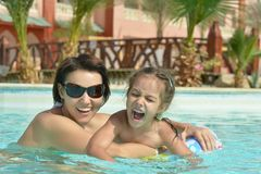 Family relax in the pool Royalty Free Stock Image