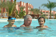 Family relax in the pool Stock Images