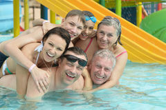 Family relax in  pool Royalty Free Stock Photo