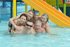 Family relax in  pool. Portrait of a happy family relax in the pool Royalty Free Stock Images
