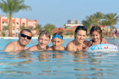 Family relax in the pool. Portrait of a happy family relax in the pool Royalty Free Stock Images