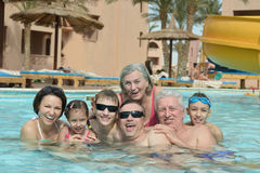 Family relax in  pool. Portrait of a happy family relax in the pool Stock Images