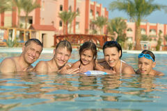 Family relax in the pool. Portrait of a happy family relax in the pool Stock Photography
