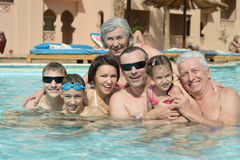 Family relax in  pool. Portrait of a happy family relax in the pool Stock Photos