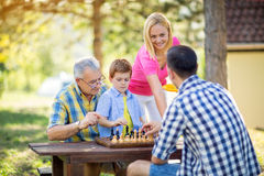 Family relax time playing chess Stock Photo