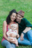 Family relaxes in a meadow Royalty Free Stock Photography
