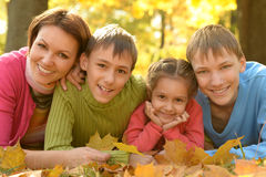 Family relaxing in autumn park Royalty Free Stock Images