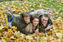 Family relaxing in autumn park Stock Photos