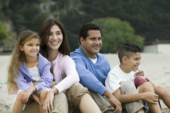 Family relaxing on beach Stock Photography