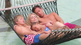 Family Relaxing In Beach Hammock stock footage