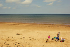 Family relaxing on the beach on Prince Edward Island Royalty Free Stock Image