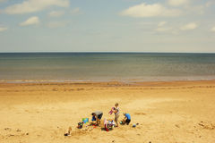Family relaxing on the beach on Prince Edward Island Royalty Free Stock Photos