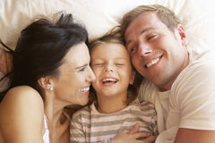 Family Relaxing In Bed Royalty Free Stock Images