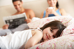 Family Relaxing In Bed Together Stock Photos