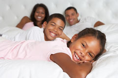 Family Relaxing In Bed Together Royalty Free Stock Image