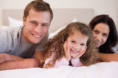 Family relaxing in the bedroom together Stock Images