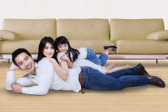 Family relaxing on the floor at home Royalty Free Stock Photography
