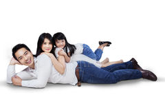 Family relaxing on the floor in the studio Stock Image