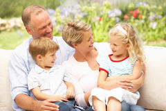 Family Relaxing In Garden Royalty Free Stock Photos