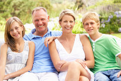 Family Relaxing In Garden Royalty Free Stock Photo