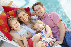 Family Relaxing In Garden Hammock Together Stock Photos